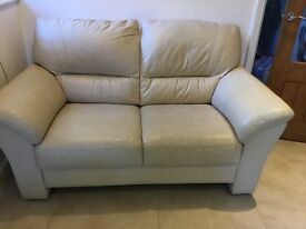 Faux leather two seater Sofa in Creamy Beige. Collection from St Albans, Herts.