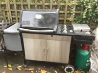 Weber Genesis Silver Outdoor Grill with two propane tanks