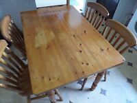 Solid pine kitchen table with 4 matching chairs