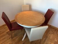 Oak and cream dining table with four matching chairs