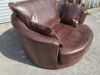 Cute Brand New brown very large (127cm) swivel cuddle love chair. Can deliver