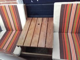 Wooden garden bench seat with table.
