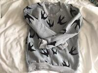 Woman's grey jumper black bird print