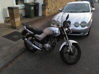 Faithful Yamaha YBR 125 great for london with straight handlebars.