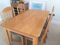 Light Oak dining table with 4 chairs