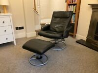 Black faux leather armchair with footstool
