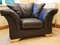 Two leather chairs plus footstool