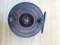 4 wooden fishing reels
