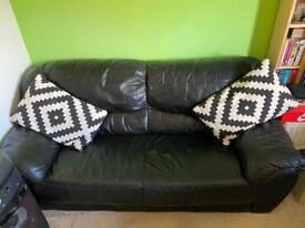 2 seater black leather settee