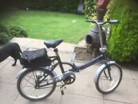 2 folding bikes, practically brand new, with extras , bag and stands, just not used