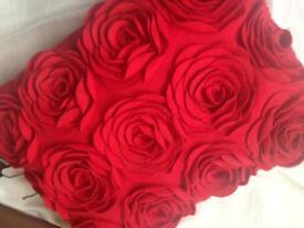 Three red felt rose cushions