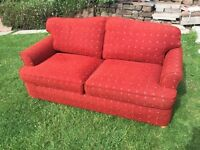 Red spotted two seater sofa bed