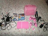 PINK PS2 SLIMLINE CONSOLE,2 SINGSTAR GAMES,MICS,2 CONTROLLERS