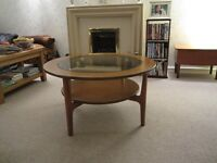 Coffee Table circular with glass top.