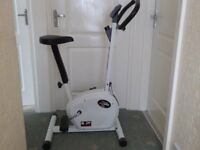White exercise bike.fully adjustable