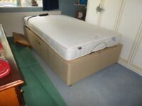 A SMALL 4' ELECTRIC ADJUSTABLE DOUBLE BED