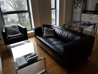 Black leather sofa and its matching armchair,modern style