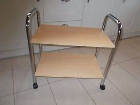 A HANDY TROLLEY TABLE IN VERY GOOD CONDITION