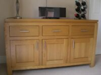 Modern design solid medium oak dining table & six chairs plus matching sideboard.