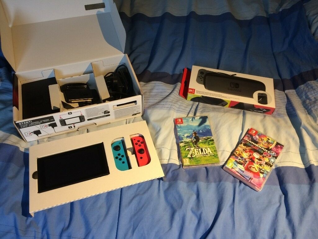 Nintendo Switch, red & blue controller, carry case, Mario Kart 8, Zelda breath of the wild