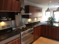 Modern kitchen with black granite work surfaces for quick sale