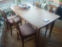 Teak dining table and pine chairs, fold out, extending, mid century, 4 or 8, vintage, wood,