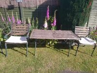 Wooden bench with cast iron legs also two chairs with cast iron legs