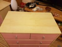 Childs pink chest of drawers and matching desk