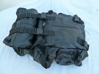 Black leather motorcycle seat pannier with attached bag.