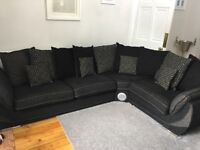 Black corner sofa with docking station. Cuddle chair also available
