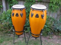 Pair of conga drums with stands