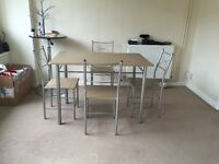 Dining table & 4 chairs as new