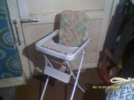 A NICE LITTLE HIGH CHAIR in nice condition FOLDS FLAT WHEN NOT in USE .+++++++++++