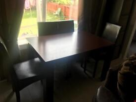 Brown table with 4 chairs