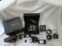 Fujifilm x100 fujinon lens with loads of extra digital camera