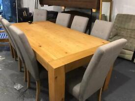 Oak dining table and 8 fabric chairs