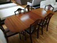 Extendable dining table with six chairs