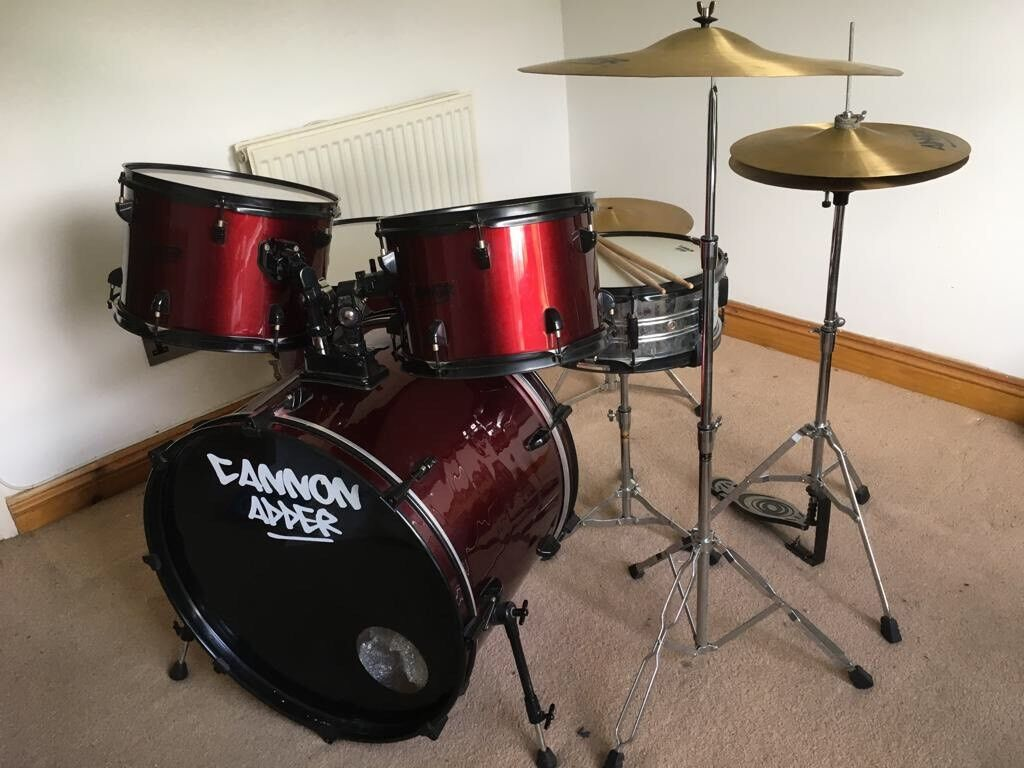 Dark red five piece drum kit with hardware and cymbals
