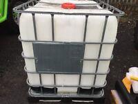 1000 litre plastic IBC container.