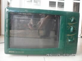 Sanyo model EM-G404 combined microwave (1.45 kW) and grill (1.3 kW)