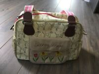 Pink lining blooming gorgeous dalmatian print changing bag