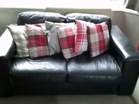 Brown leather sofa, good condition.
