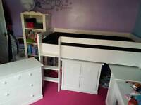 Single cabin bed with matteress chest of drawers and a little wardrobe
