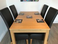 Ikea wooden extendable table with 4 chairs.