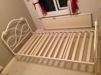 As new solid and sturdy powder coated cream scrolled metal bed frame for sale.