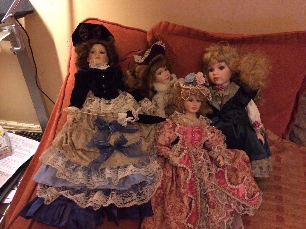 Four porcelain dolls