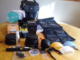 Nikon D5300 wi-fi/18-140mm lens.This comes with accessories as in description.cost new £640