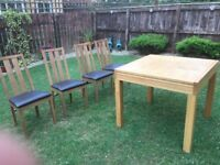 Solid wood extendable dining table with four chairs