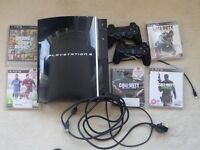 PS3 (Sony PlatStation 3) plus 5 games, 2 controllers.