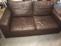 Brown leather bed sette